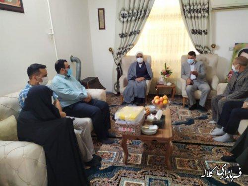 فرماندار کلاله با خانواده شهید بارانی و کارمند جانباز در شهر کلاله دیدار کرد